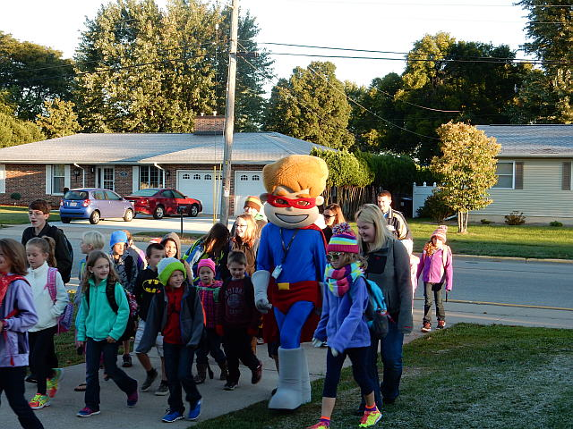 "Altra Credit Union's mascot ""Cash"" leads the walking school bus on October 2.  Click the picture for more information."