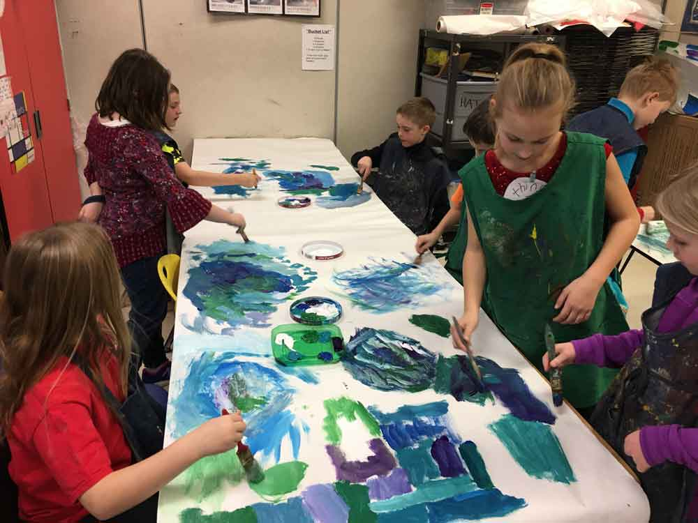 3rd graders prepare scenery for their upcoming music program in art class