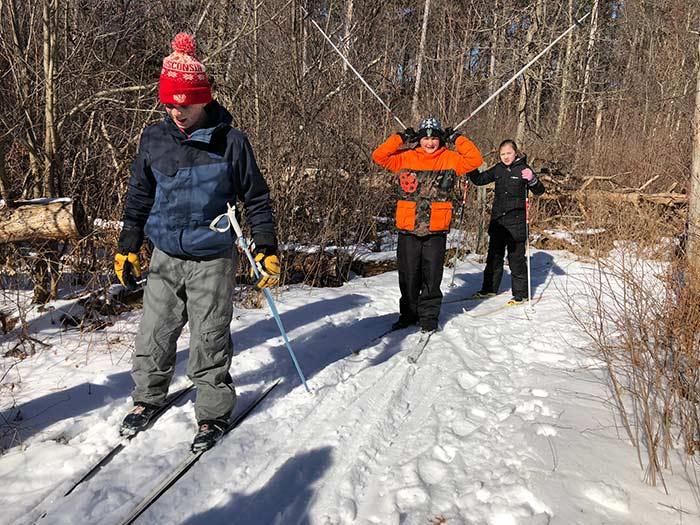 Students try out their cross country skiing skills after learning about it from their classmates.