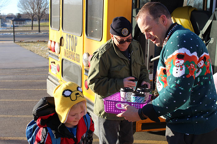 Mr. Rieber and one of Mrs. Reedy's first graders thank our bus drivers for their hard work with some hot chocolate.