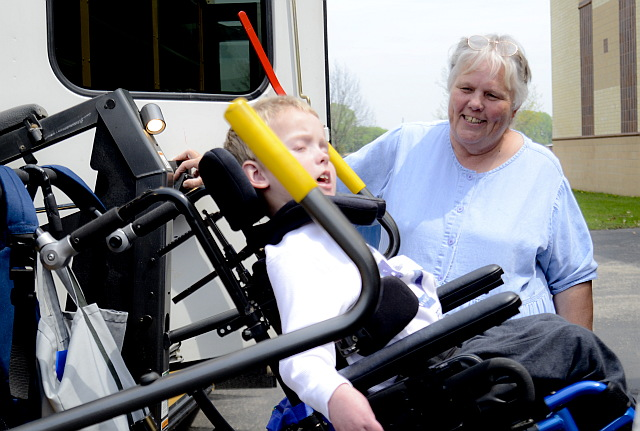 Betty Hanson, 20+ year vehicle driver, transports a student to school.